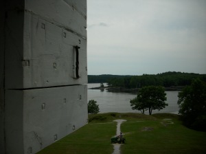 The view from the 2nd floor of the Blockhouse with earthwork and Sheepscot River in distance (and yes, that is the park ranger mowing the lawn)